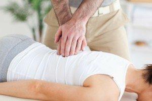 chiropractor adjusting woman's back
